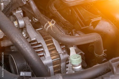 Engine room of car focus on alternator with flare light. Canvas Print