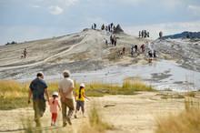 Tourists Visiting Mud Volcanoes In Summer Season