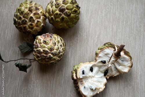 Obraz Sugar apples (Annona squamosa) on neutral background. - fototapety do salonu