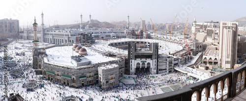MECCA, SAUDI ARABIA - MAY 02 2018: Outstanding wide panoramic view on entire Masjid Al Haram mosque from Clock Tower Abraj Al Bait. Visible center to horizon, aerial skyline view. Crowd of people down