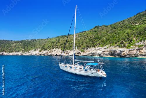 Beautiful bay with sailing boat, Antipaxos island, Greece