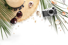 Flat Lay Composition With Stylish Hat, Camera And Beach Objects On White Background