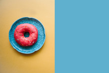 Donut On A Bright Colored Background In A Minimal Style. Nearby Place For Text