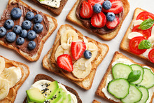 Tasty Toast Bread With Fruits, Berries And Vegetables On Light Background, Closeup