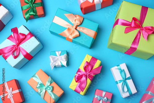 Flat lay composition with beautiful gift boxes on color background