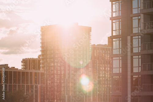 Fototapety, obrazy: Bottom view of modern skyscrapers in business district against blue sky.