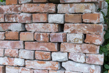 Old Loosely Stacked Bricks To A Wall