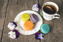 Tea With Colorful Macaroons And Flowers Served On Wooden Table