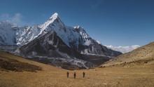 Hikers Walking On Landscape Ag...