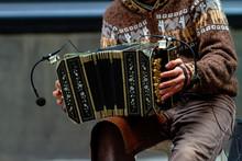 Close-up Of Street Bandoneon Player Playing Tango