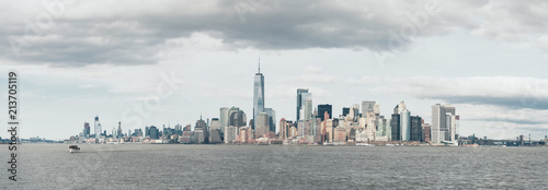 Panoramic view of cityscape by Hudson River against cloudy sky - 213705119