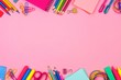 School supplies double border against a pastel pink paper background