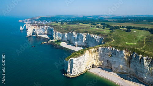Платно Drone view of seashore cliffs in Etretat France with a golf course