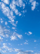 Blue sky with many white clouds during the day. Portrait
