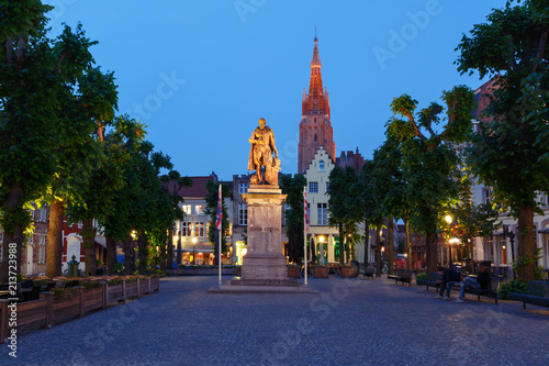Wall Murals Bridges The Simon Stevin Square or Simon Stevinplein during evening blue hour, Church of Our Lady on the background, Bruges, Belgium