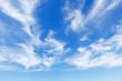 Leinwandbild Motiv Beautiful blue sky over the sea with translucent, white, Cirrus clouds