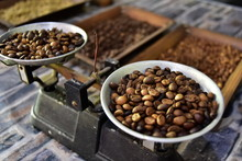 Untreated Coffee Beans On Old Scales