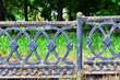 Very old metal fence. Vintage street design element