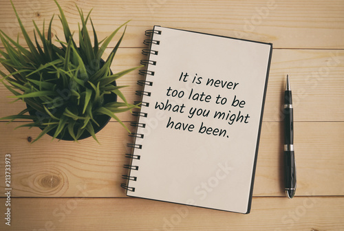 Photo  Inspirational and motivation life quote on note pad - It is never too late to be what you might have been