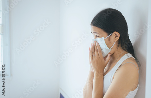 Valokuva  Concept of health woman using protective mask with cold blowing and runny nose o
