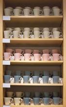 Mugs On The Shelves In The Sho...
