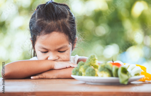 Valokuvatapetti Asian child does not like to eat vegetables and refuse to eat healthy vegetables