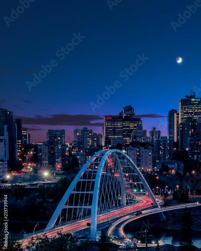Keuken foto achterwand Stad gebouw Light trails as traffic goes across the new bridge during blue hour in Edmonton (YEG), Alberta , Canada.