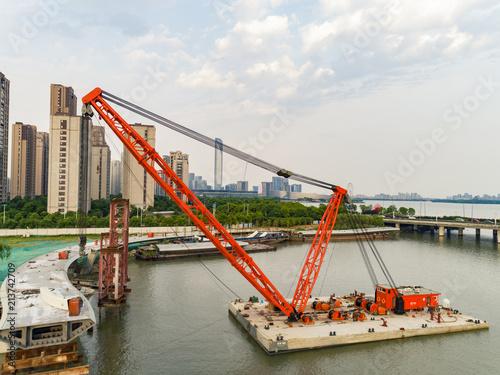 Valokuva Aerial view of floating crane, pedestrian bridge construction