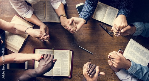 Fotografie, Obraz  Group of people holding hands praying worship believe