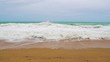 waves beat against the sandy beach in slow motion, the tropical seaside