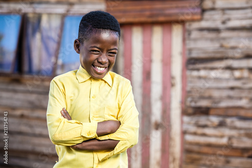 Valokuvatapetti Black boy with a naughty smile on his face