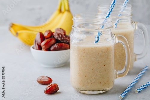 Tuinposter Milkshake Banana and date fruit smoothie or milkshake in glass mason jar