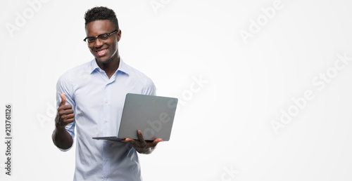 Fotografie, Obraz  Young african american businessman using computer laptop happy with big smile do