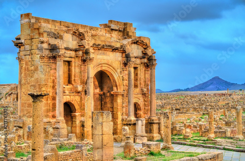 Wall Murals Algeria Trajan Arch within the ruins of Timgad in Algeria.