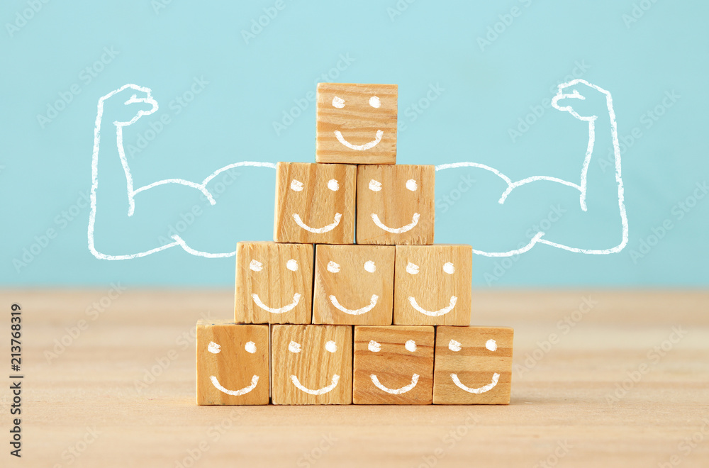 Fototapeta image of wooden blocks with people icons over table ,building a strong team, human resources and management concept.