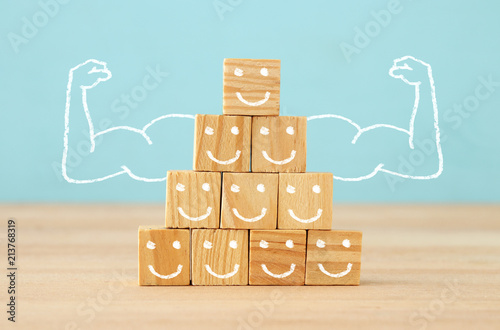 Fototapeta image of wooden blocks with people icons over table ,building a strong team, human resources and management concept. obraz