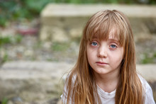 Portrait Of Sad Vulnerable Little Girl In Dirty Alley, Shallow Depth Of Field.