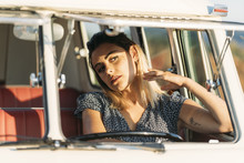 Young Woman Inside Old Van