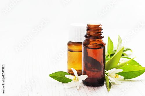 Neroli citrus aurantium essential oil in a brown glass bottle with neroli citrus aurantium essential oil in a brown glass bottle with fresh white flowers mightylinksfo