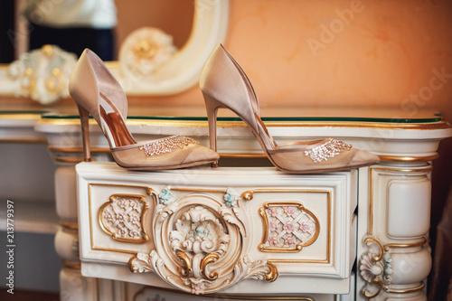 Fotografija Bridal accessories. Elegant and stylish bridal shoes.