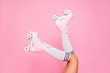 Leinwanddruck Bild - Close up photo of woman's body part. Legs wearing cute sweet with shoelaces four wheeled roller blades isolated tanned bright vivid background