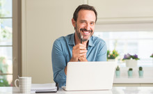 Middle Age Man Using Laptop At...