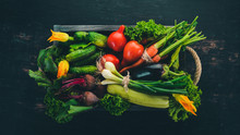 A Set Of Fresh Vegetables In A Wooden Box. On A Wooden Background. Top View. Copy Space.