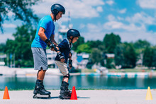 Grandfather And Grandson Roller Skating