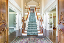 Grand Two Story Foyer With Ele...