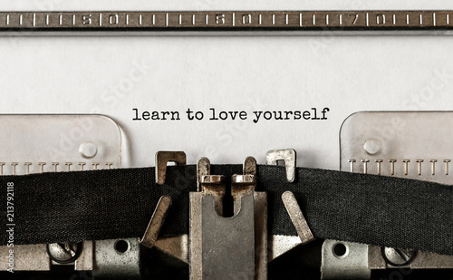Text Learn to love yourself typed on retro typewriter Wallpaper Mural