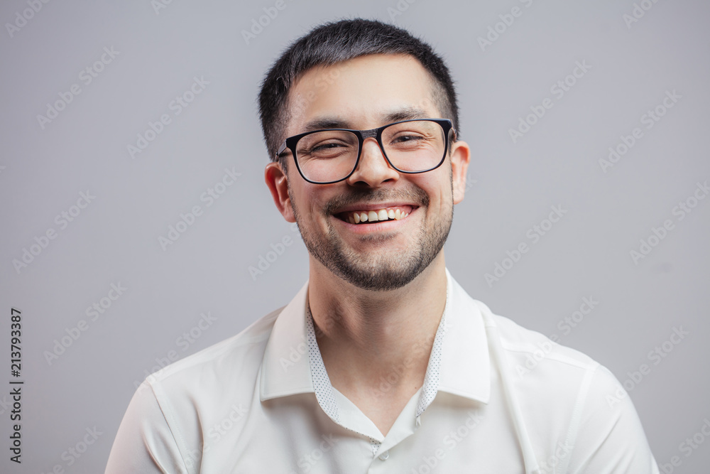 Fototapeta carefree positive male in glasses. cheerful man rejoicing at the good business news