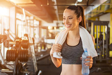 Beautiful Smiling Young Fit Woman With Towel And Water Bottle Preparing For Sports Training In Gym