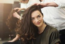 Woman Sitting At Beauty Salon, Making Hairdo