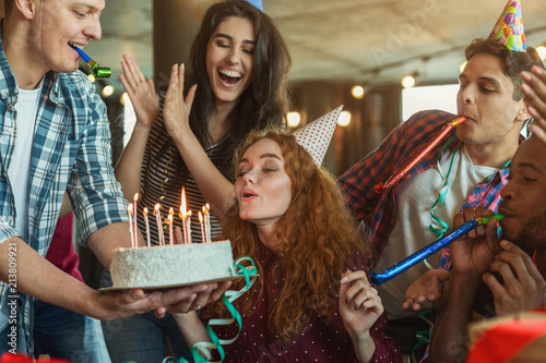 Obraz Friends presenting birthday cake to girl - fototapety do salonu